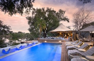 Relax by the pool at Thorntree River Lodge and watch the world slowly pass by.