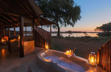 Enjoy spectacular views over the Zambezi whilst having a bath