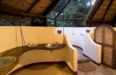 Large bathrooms and outdoor showers are a feature of all chalets at Nkwali