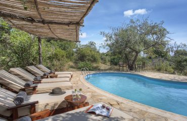 Cool off between safari activities in the inviting swimming pool
