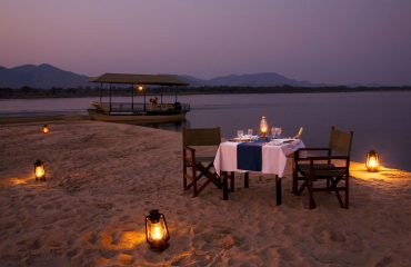 Enjoy a beautiful dinner on an isolated sandbank on the Zambezi River