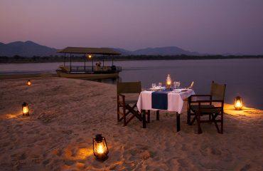 Enjoy a beautiful dinner on an isolated sandbank on the Zambezi River