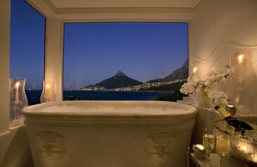 A bath with a view. Relax with ocean views and the famous Lions Head mountain peak in the distance
