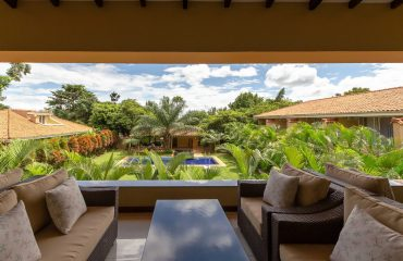 Relax on the comfortable verandah overlooking the beautiful gardens.