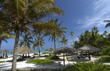 Palm trees and pristine white sand epitomises the beach scene at Breezes.