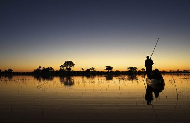 A makoro safari meandering along the serene water channels of the Okavango Delta at sunset is a truly magical experience.