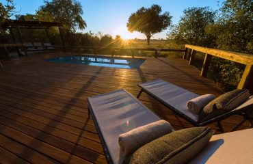 The pool deck at Kwando Splash is the ideal place to relax between safari activities.