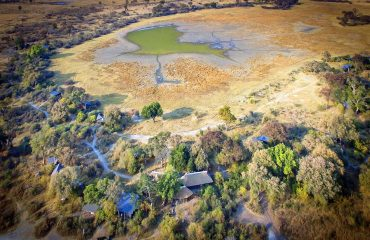 An aerial view of Kwando Splash Camp, demonstrating its wilderness location in the Okavango Delta