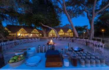 Enjoy breakfast around the fire at Kwando Splash Camp before your early morning game drive.