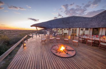 The deck area at Tau Pan offers unparalleled views of the vast Kalahari Desert.