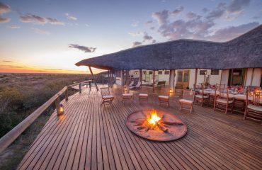 The deck area at Tau Pan offers unparalleled views of the vast Kalahari Desert.