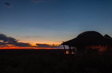 Another day in paradise ends as the sun sets over the Kalahari Desert.