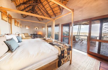 Large folding doors open out onto the vast Kalahari Plains. Welcome to another day at Tau Pan.