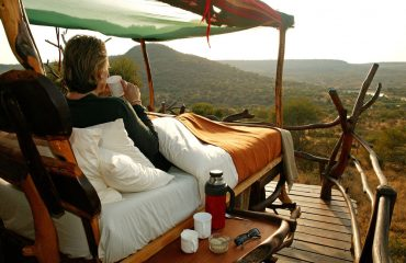 A serene experience overlooking the vast wilderness with a fresh cup of coffee