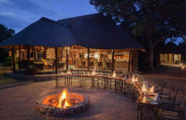 Dining around the camp fire under the African night sky is the perfect end to a day on safari.